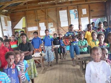 Kerau Community School students in their classroom built using bush materials while MP Mona rolls out schools for well to do schools. Very responsible aye?