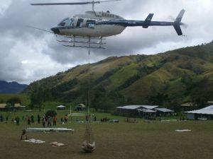 Chopper Taking off to Kerau with School Materials  - Digicel Foundation Inc