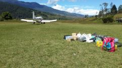 Woitape Airstrip - Plane Taking off after Drop off