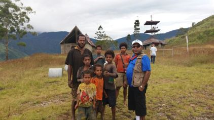 The locals in Guari takes a photo with their local MP.