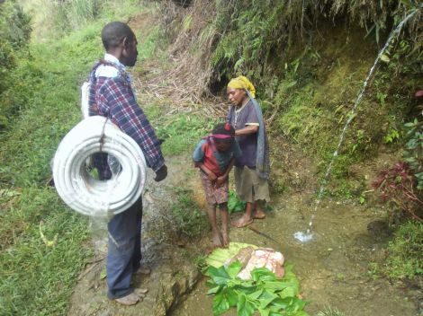Locals carry ductings for VSAT cables - Omu