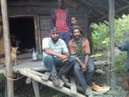 Telikom Technician Derrick with Locals at Omu
