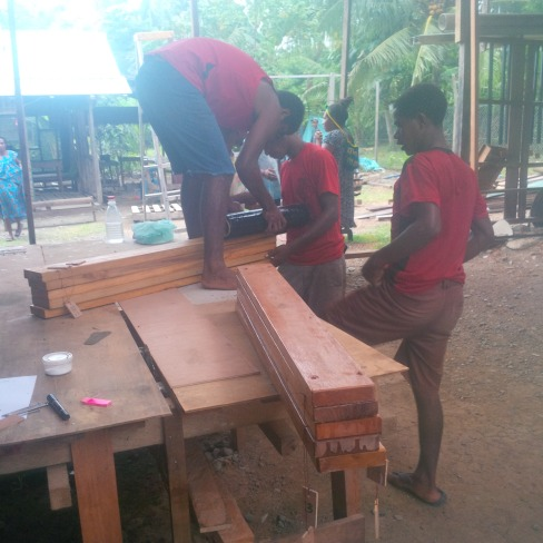 Workers packing desks for dispatch