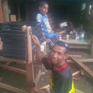 Archeron Morant and Akera Maino - packing desks for Sopu